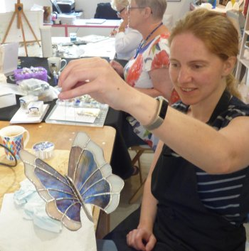 A stained glass butterfly made by Nicola on a workshop with Vitreus Art