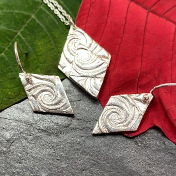 Textured silver earring and pendant set made by Jennifer-Ann Jewllery at Vitreus Art