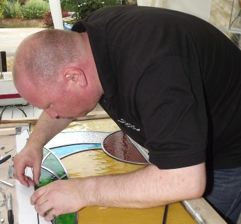 Mike working on a leaded stained glass panel