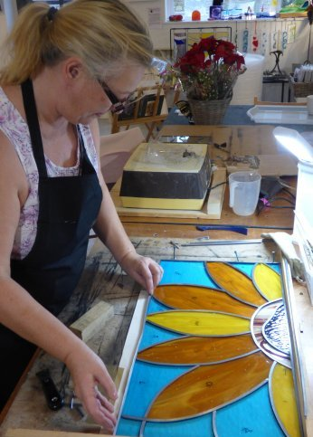 A stained glass leaded window being created