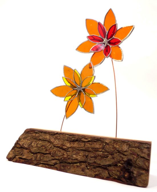 Copper foiled stained glass flowers on a reclaimed wooden base made by Vitreus Art
