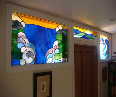 Three water-themed stained glass panels commissioned fora  period home